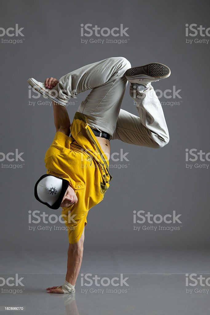 Break dancer stand on one arm stock photo