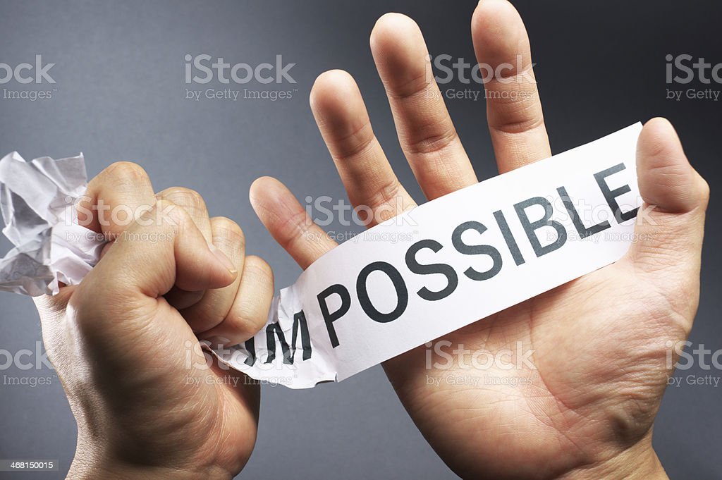 Break down the impossible. stock photo