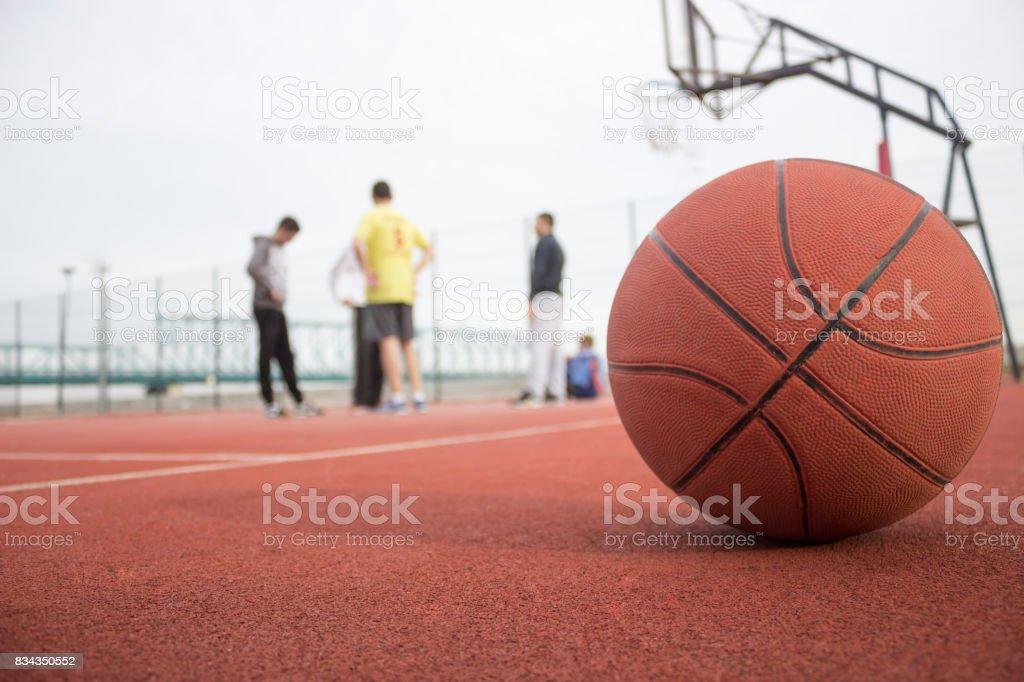 Break during playing basketball stock photo