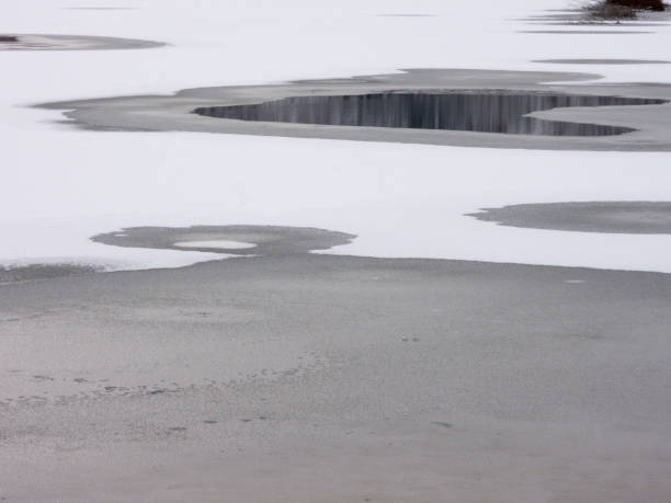 Break in the surface of a frozen lake stock photo