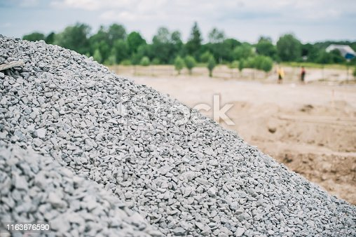 Break stones on construction site. Breakstone background. Gravel texture. Crushed Gravel background.