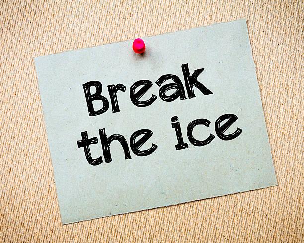 Break the ice Break the ice Message. Recycled paper note pinned on cork board. Concept Image breaking the ice stock pictures, royalty-free photos & images