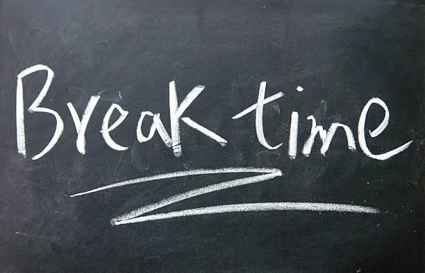 break time sign written with chalk on blackboard stock photo