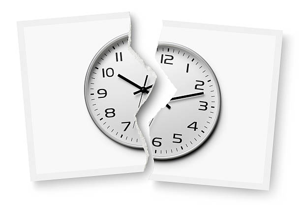 Break time. Torn photograph of a clock. stock photo