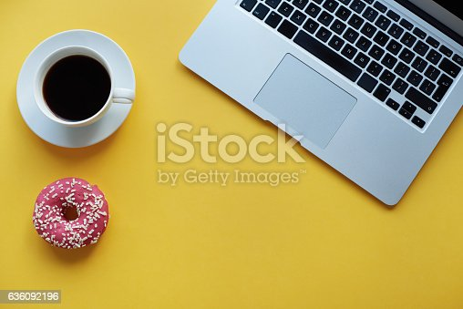 istock Break time with coffee and donut 636092196