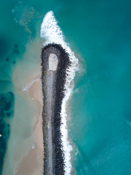 Break Water Aerial Aerial photograph of a break water groyne stock pictures, royalty-free photos & images