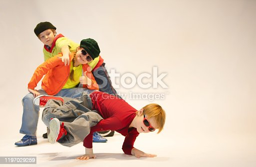 The boy in the dance pose and his friends