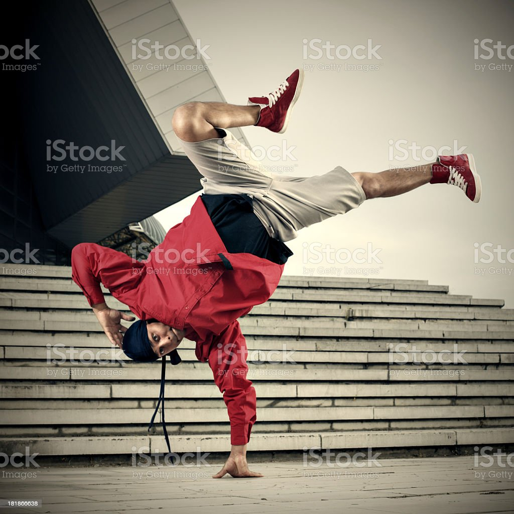 Breakdancer doing one hand stand stock photo