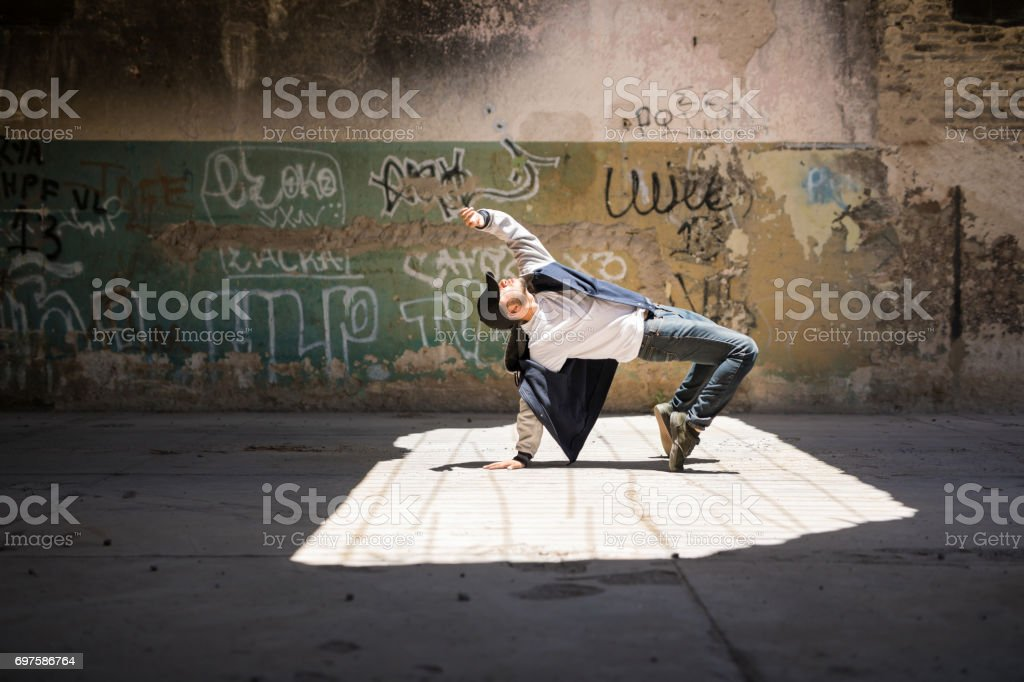 Breakdancer performing in an urban setting stock photo