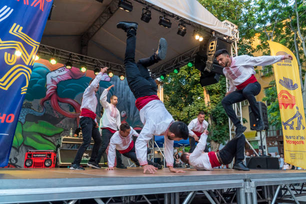 Breakdancers dressed with traditional bulgarian clothes stock photo