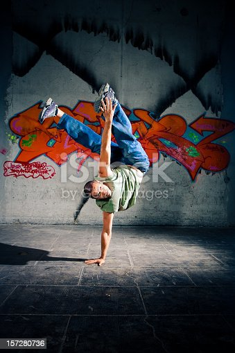 Young man breakdancing