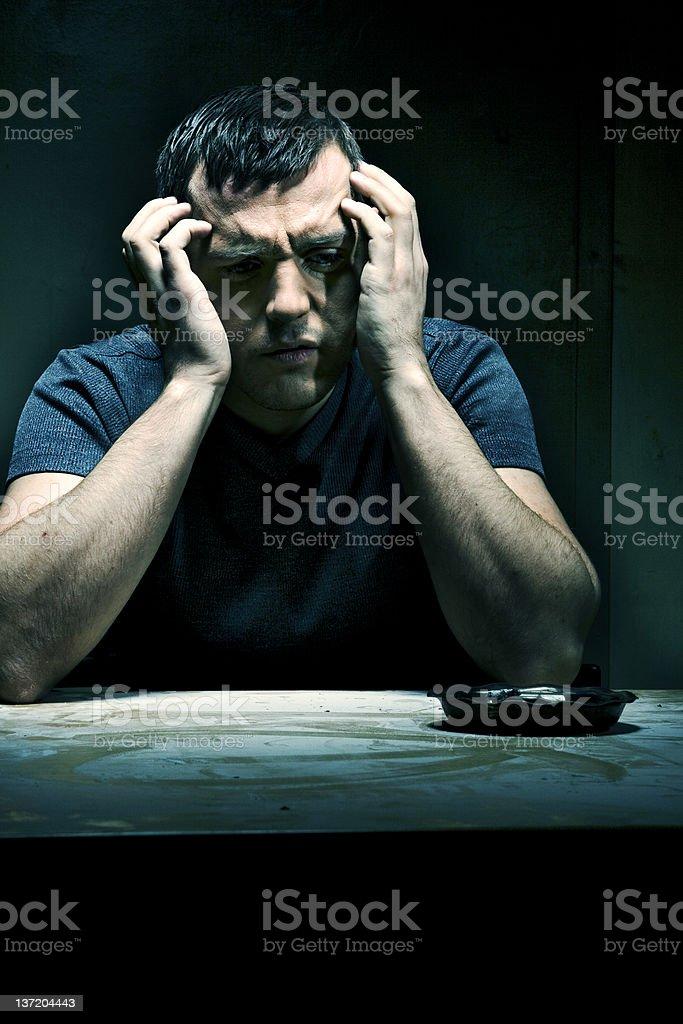 Low-key portrait of depressed man.