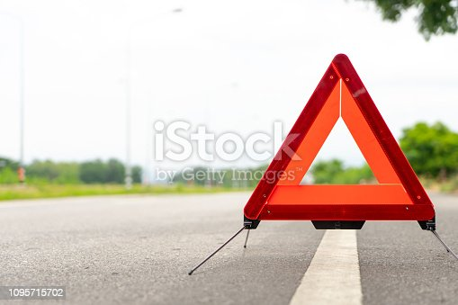 istock breakdown triangle stands alongside the road. Car broke down sign on road concept. 1095715702