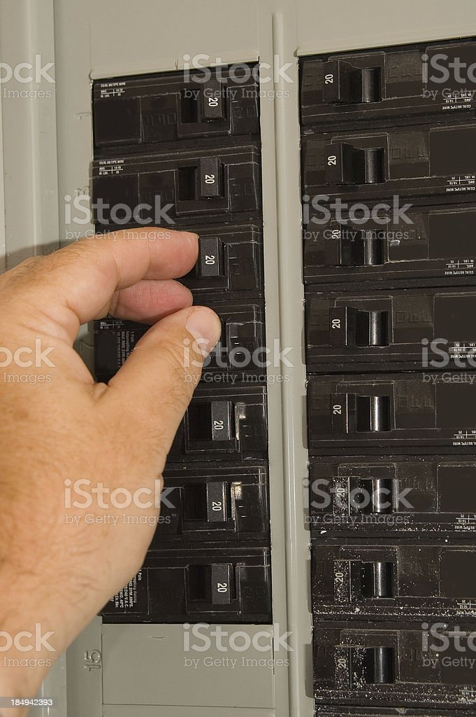 Breaker box and hand stock photo