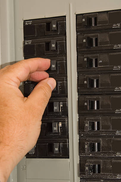 breaker box and hand - fuse box stock photos and pictures