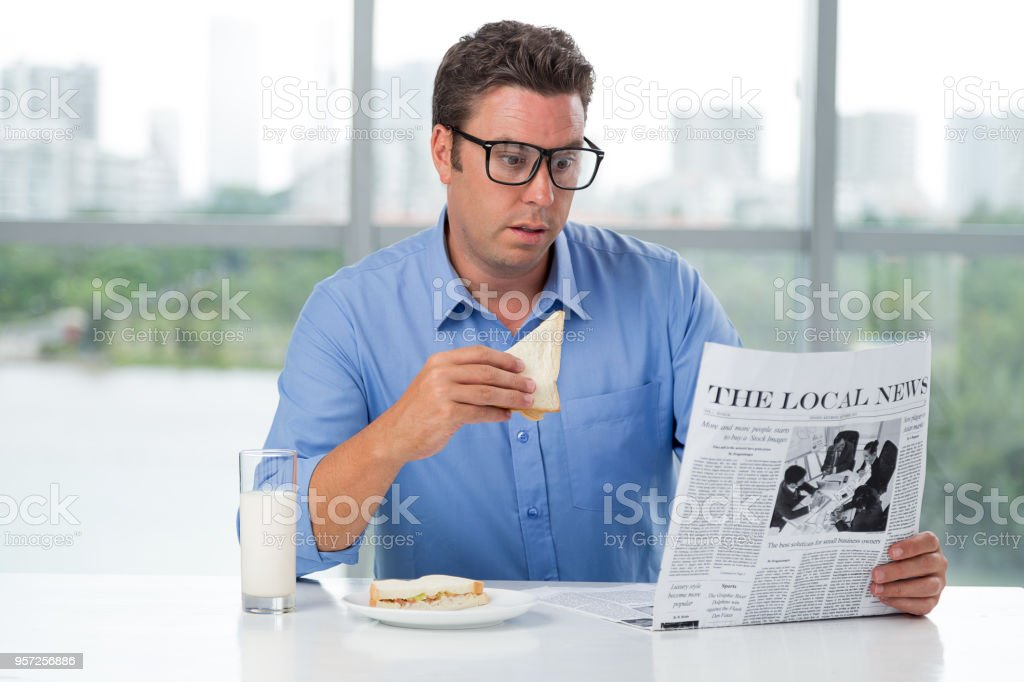 Breakfast and news stock photo