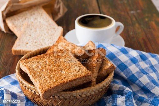 istock Breakfast background, toast and coffee on rustic wood 892740022
