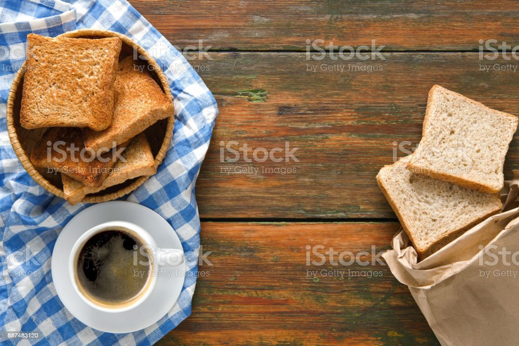Breakfast background, toast and coffee on rustic wood, top view with...