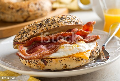 A delicios breakfast bagel with bacon, egg and cheese.