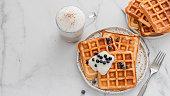 istock Breakfast belgian waffles, cappuccino. Copy space 1192818486