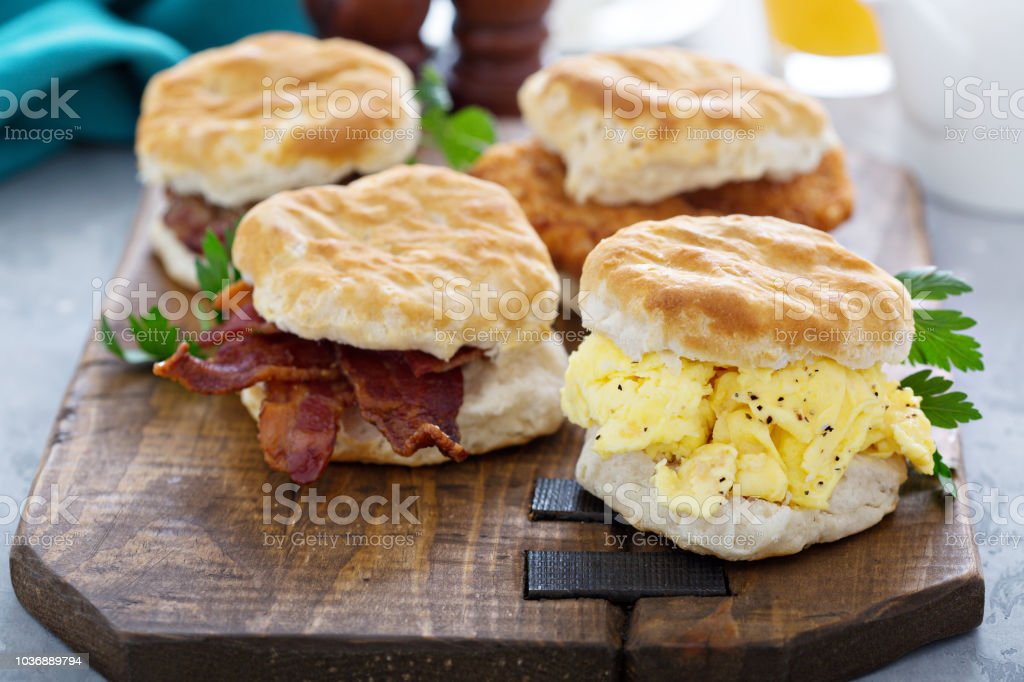 Breakfast biscuits with soft scrambled eggs and bacon stock photo