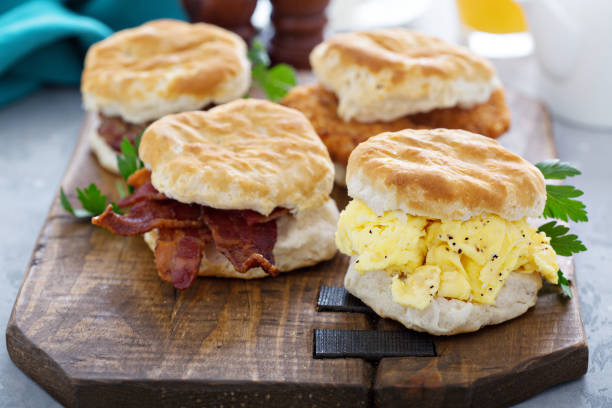 Breakfast biscuits with soft scrambled eggs and bacon Breakfast biscuits with soft scrambled eggs, bacon, sausage and chicken biscuit stock pictures, royalty-free photos & images