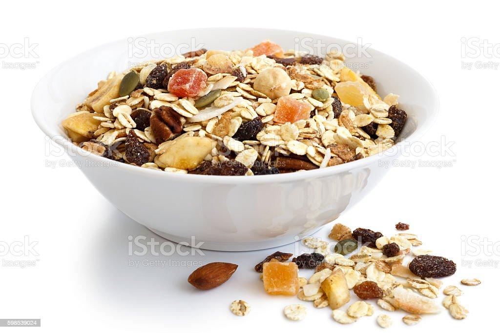 Breakfast bowl of fruit and nut muesli on white. photo libre de droits