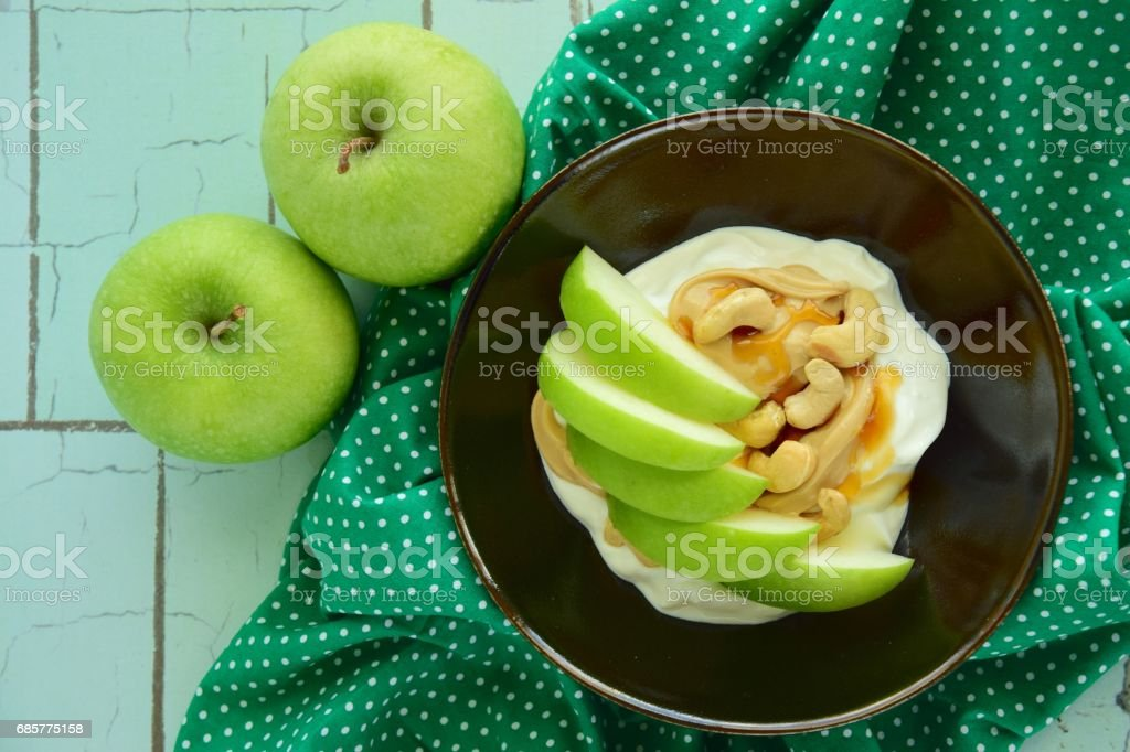 Breakfast bowl with yogurt, cashew and apple royalty-free stock photo