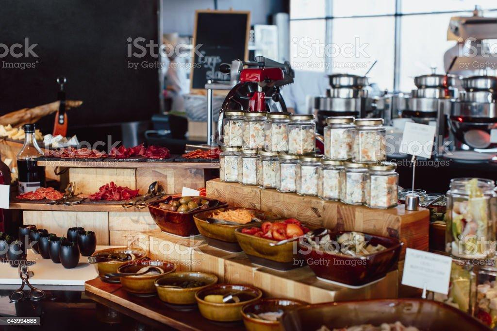 Breakfast buffet in the restaurant open kitchen stock photo
