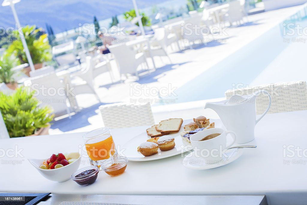 Breakfast by the Pool in Luxury Hotel royalty-free stock photo
