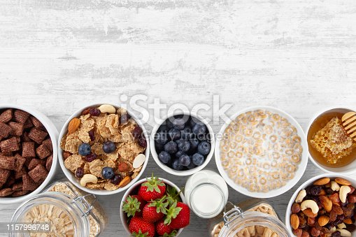 Healthy food concept with breakfast cereal and fresh berries on white wooden table with copy space