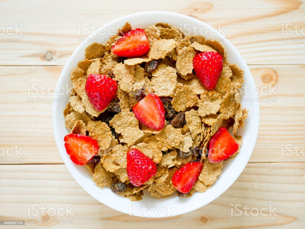 Breakfast cereal with raisin and fresh strawberries stock photo