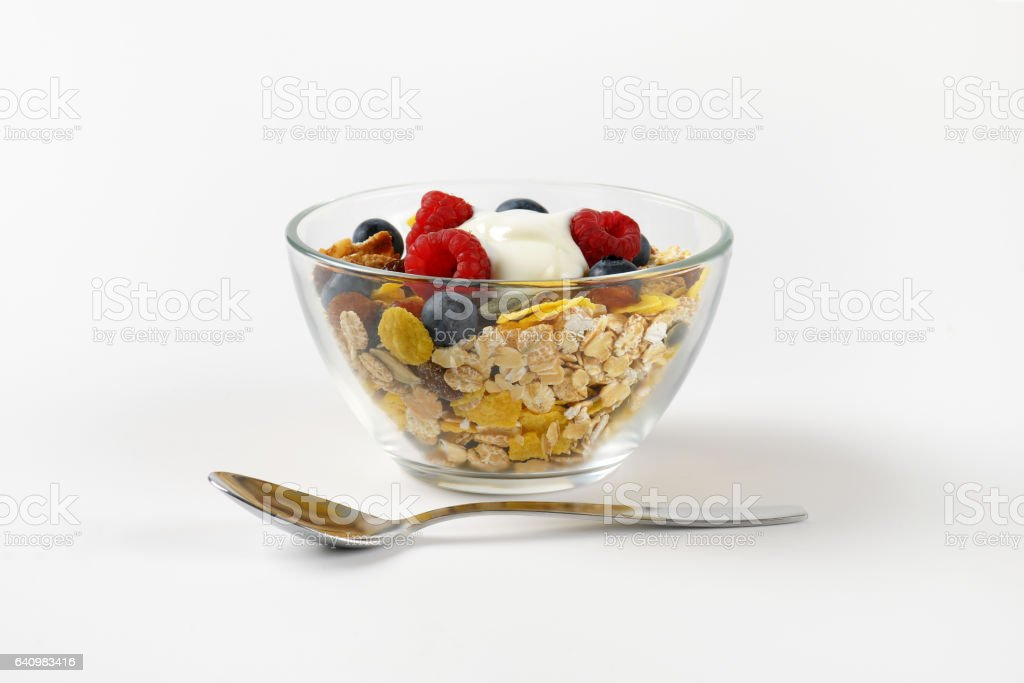 breakfast cereals with berry fruit and white yogurt stock photo