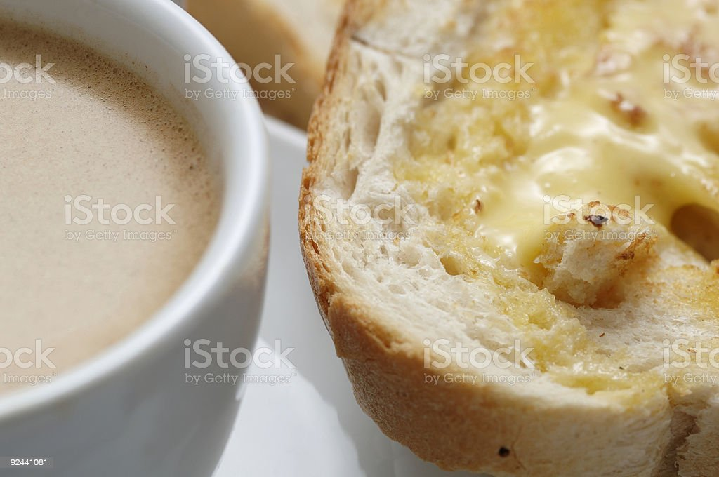 breakfast, coffee and buttered toast macro royalty-free stock photo