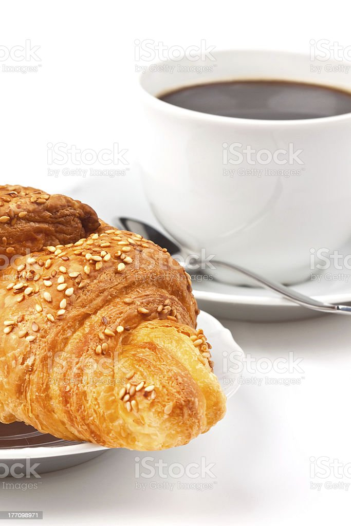 Breakfast: coffee and croissant with sesame seeds royalty-free stock photo