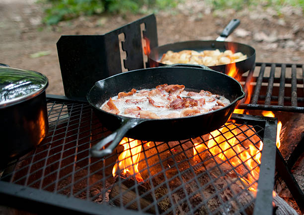 Breakfast cooking on an outdoor fiery grill stock photo