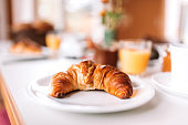 istock Breakfast - Croissant on table 875592182