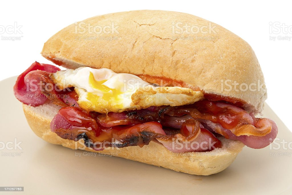 Breakfast egg and bacon roll with tomato ketchup stock photo