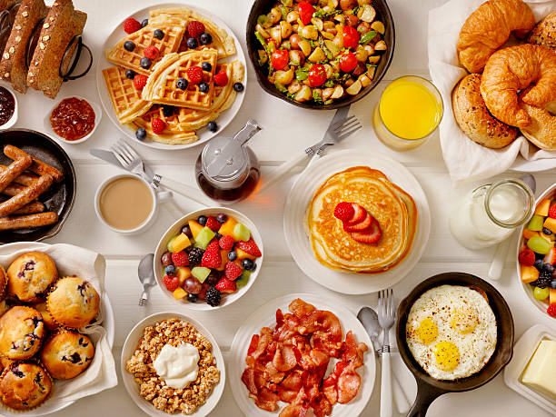 breakfast feast - breakfast stock photos and pictures