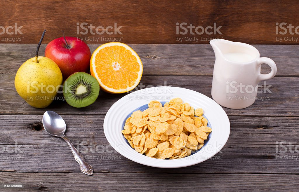 Breakfast: flakes in a plate, milk in a jug stock photo