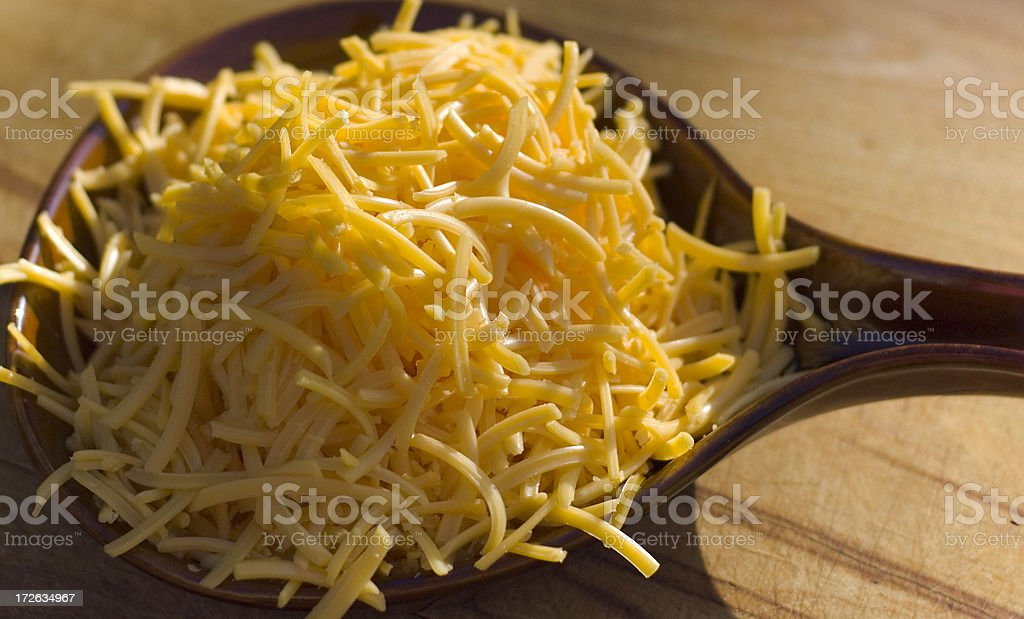 Breakfast Food Preparation; Grated Cheddar Cheese in Skillet royalty-free stock photo