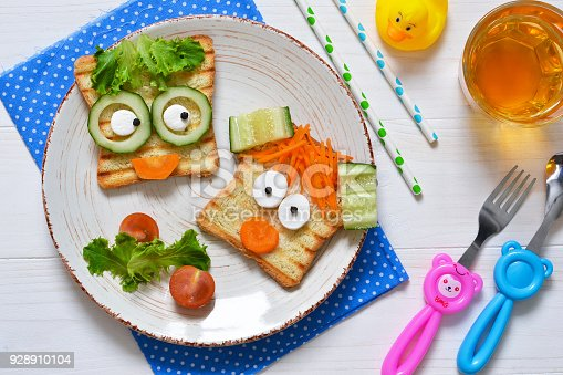 istock Breakfast for a child - children's funny toasts with a grilled and carrot. 928910104