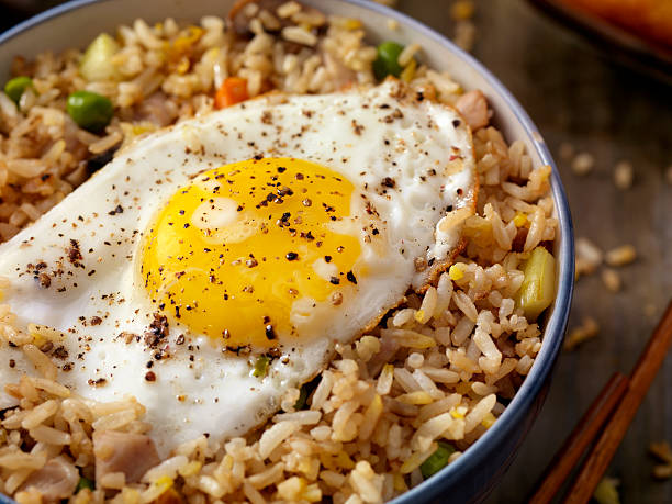 Breakfast Fried Egg with Rice Breakfast Fried Egg with Rice -Photographed on Hasselblad H1-22mb Camera fried rice stock pictures, royalty-free photos & images