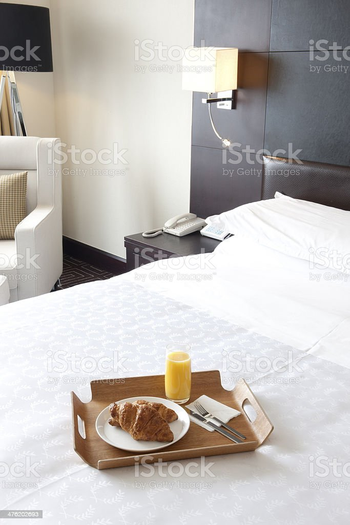 Breakfast in bed at a hotel room royalty-free stock photo