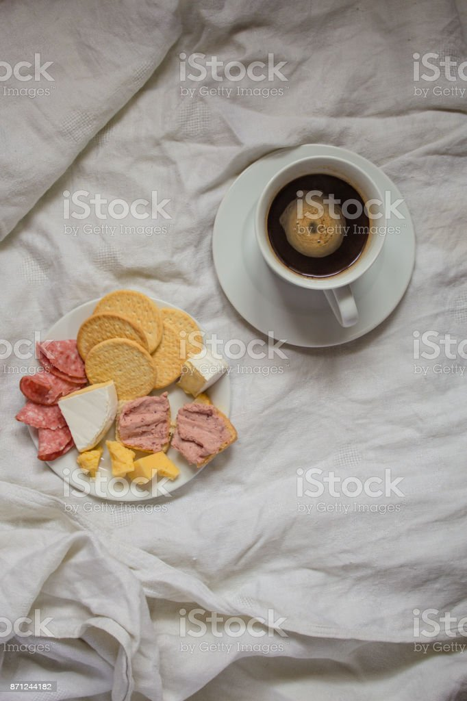 a plate with tasty snacks and a cup of fragrant coffee