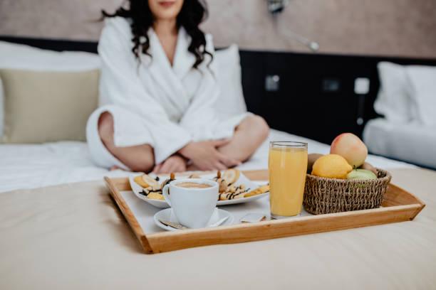 Breakfast in bed in hotel room stock photo