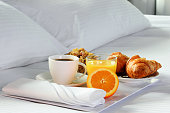 Breakfast in bed in hotel room.