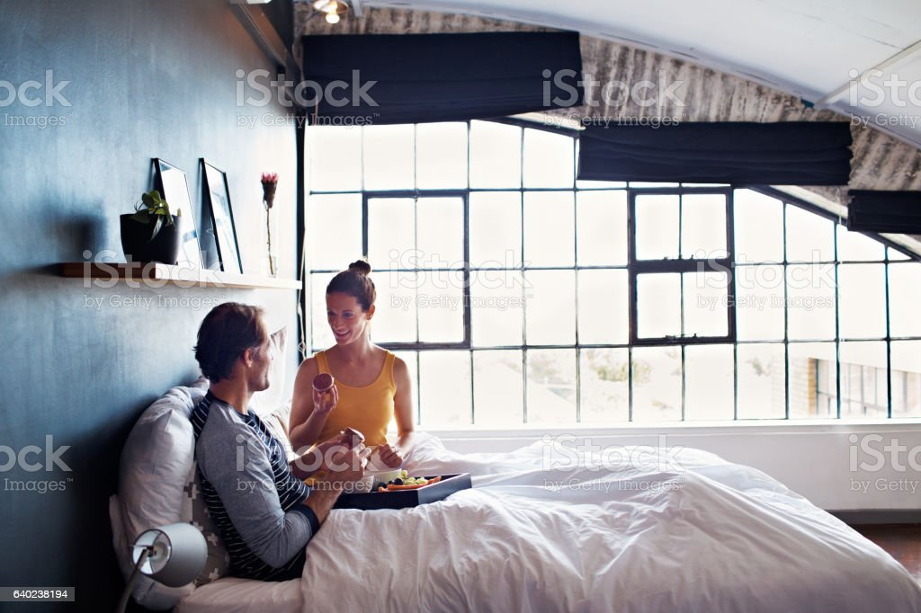 Breakfast in bed is always on their weekend menu stock photo