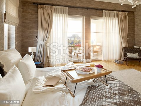 wide angle shot of a comfortable bedroom