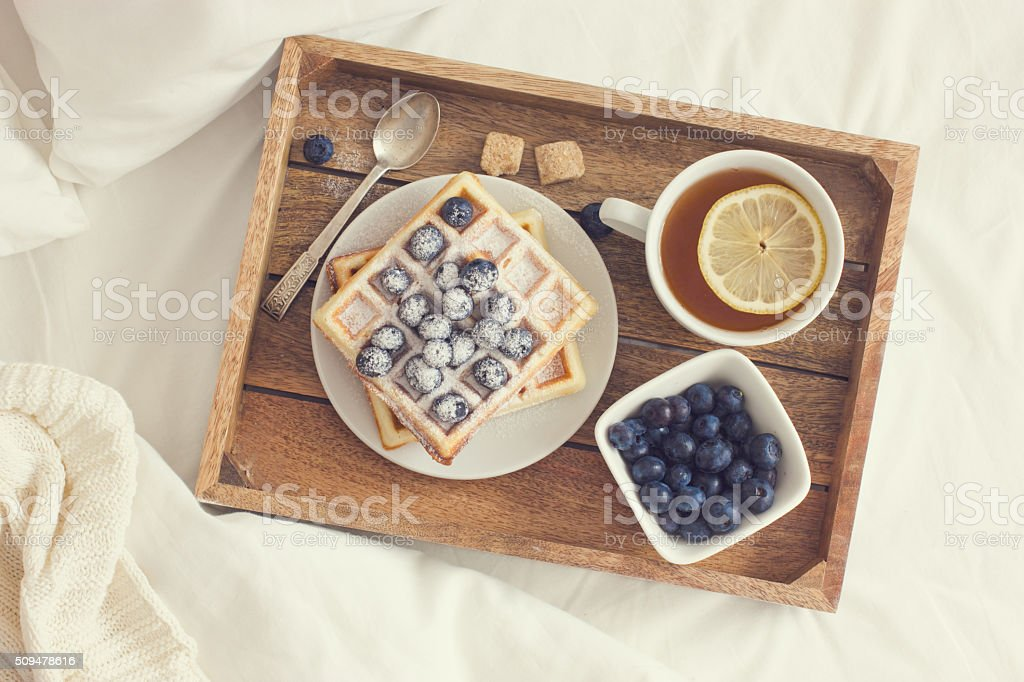 breakfast in bed,  tray with belgian waffles with blueberry and bildbanksfoto